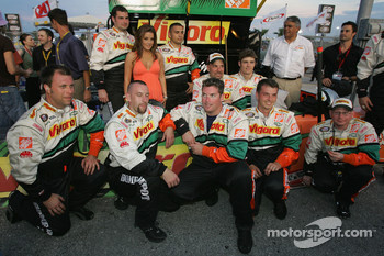 Lisa Marie Presley poses with Vigoro Home Depot Chevy crew members