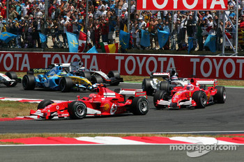 First of lap: Michael Schumacher ahead of Rubens Barrichello