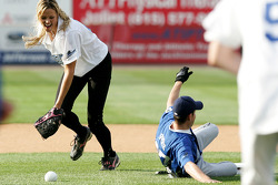 Jennie Finch of the Chicago Bandits softball team is late getting to the ball as NASCAR driver Kurt Busch slides into second base during the Racin' the Bases Celebrity Softball game benefitting the Victory Junction Gang Camp