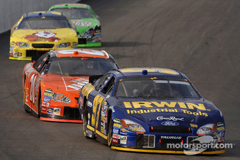 Kurt Busch leads Tony Stewart
