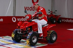 Vodafone event at Hockenheim Talhaus: Michael Schumacher paints with a quad bike