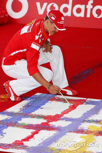 Vodafone event at Hockenheim Talhaus: Michael Schumacher signs his artwork