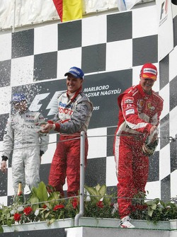 Podium: champagne for Kimi Raikkonen, Michael Schumacher and Ralf Schumacher
