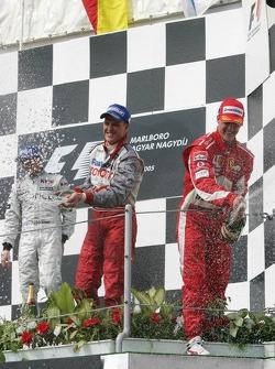Podium: champagne for Kimi Raikkonen, Michael Schumacher and Ralf Schumacher