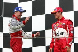 Podium: Ralf Schumacher and Michael Schumacher