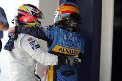 Fernando Alonso celebrates with Juan Pablo Montoya