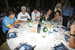 Fernando Alonso with other members of his team at their table