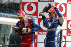 Podium: champagne for Heikki Kovalainen and Nelson A. Piquet