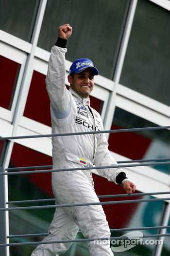 Race winner Juan Pablo Montoya heads to podium