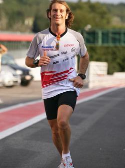 Jarno Trulli jogs on the track