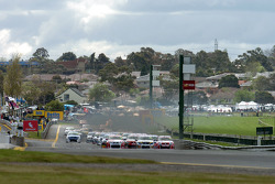 Craig Lowndes takes the lead from Garth Tander