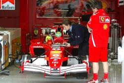 A FIA technician checks the Ferrari