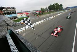 Scott Dixon takes the checkered flag