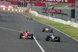 Kimi Raikkonen passes Michael Schumacher