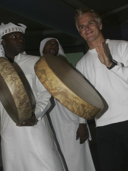 Heikki Kovalainen with local drummers