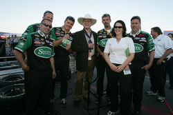 Actor Larry Hagman poses with Roush Racing team members