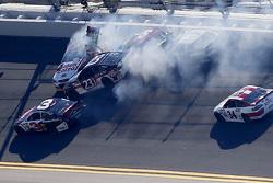 J.J. Yeley, BK Racing Toyota, Reed Sorenson, Team Xtreme Racing Chevrolet, Clint Bowyer, Michael Waltrip Racing Toyota in a crash during qualifying