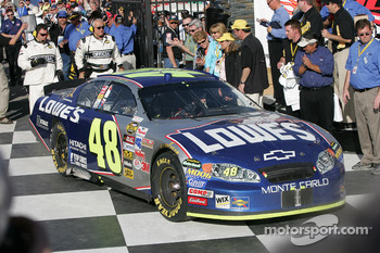 Victory lane: race winner Jimmie Johnson arrives