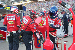Greg Biffle's team retrieve the gas from the catch can