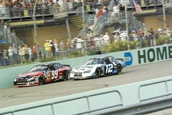 Carl Edwards and Ryan Newman battle for the lead
