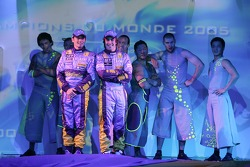 Fernando Alonso and Giancarlo Fisichella on stage with performers