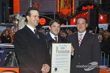 Tony Stewart receives Proclamation to New York City with New York City sports commissioner Ken Podzibla, representing NYC mayor Michael Bloomberg, and Sprint Nextel vice president of sports marketing Michael Robichaud