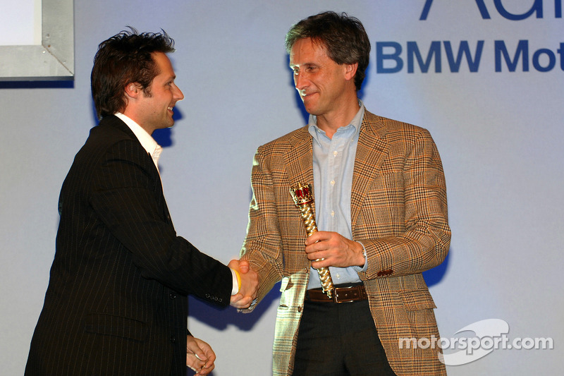 Andy Priaulx gets the world Champions Septre from Roberto Ravaglia