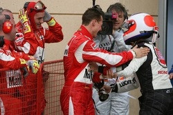 Pole winner Michael Schumacher celebrates with Rubens Barrichello