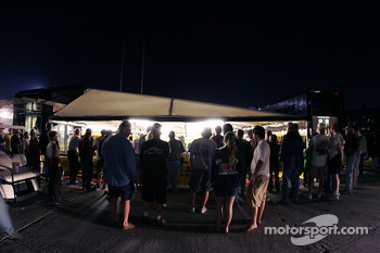 Fans watch activity in the Penske Motorsports paddock area