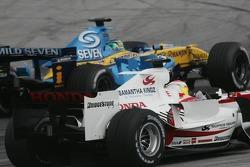 Giancarlo Fisichella passes Yuji Ide