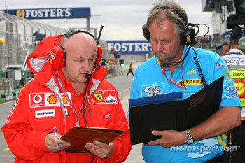 Ferrari and Renault team members swap data