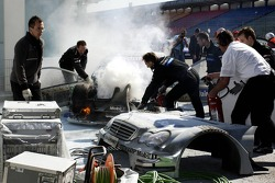 Bruno Spengler stopped at pitlane entrance with a big fire