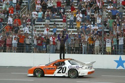 Tony Stewart celebrates on the front straight
