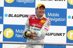 Podium: champagne for Tom Kristensen