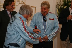Bernie Ecclestone and Herbie Blash, FIA observer in the retro jackets they once worn when they worked together at Brabham F1