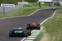 Fernando Alonso chases Michael Schumacher
