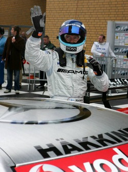 Mika Hakkinen waves to the fans after securing 2nd place in qualifying