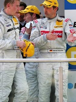Podium: Bernd Schneider and Mika Hakkinen