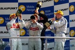 Podium: champagne for Bernd Schneider, Tom Kristensen and Mika Hakkinen
