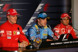 Press conference: pole winner Fernando Alonso with Michael Schumacher and Felipe Massa
