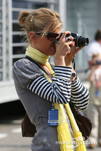 A girl in the paddock takes a photo