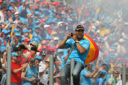 Fans celebrate Fernando Alonso's win