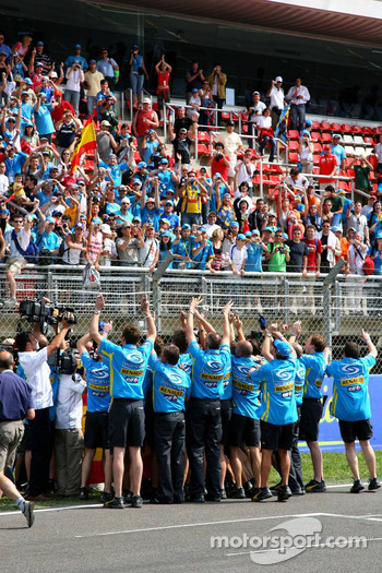 Fernando Alonso and Renault F1 team members celebrate with the fans