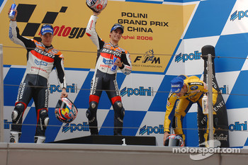 Podium: race winner Dani Pedrosa with Nicky Hayden and Colin Edwards