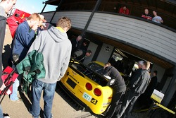 Fans watch as the Corvette Racing crew works on the Corvette C6-R