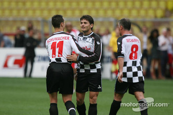 Charity football match: Michael Schumacher congratulates Giancarlo Fisichella