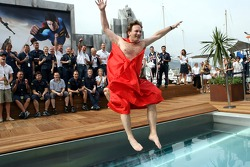 The team of Red Bull Racing and sporting director Christian Horner in a Superman cape jumps into the pool on the deck of the Red Bull Energy Station