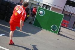 Ferrari mechanic plays a bit of football