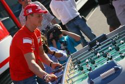 Michael Schumacher plays table football