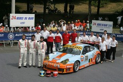 Yves Lambert, Christian Lefort, Romain Iannetta, and the Ice Pol Racing Team pose with the Ice Pol Racing Team Porsche GT3 RSR